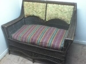 Antique wicker loveseat and two chairs
