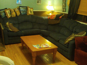 very well loved sectional couch , dark blue