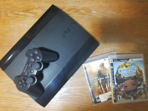 PS3 with 1 controller and 2 games