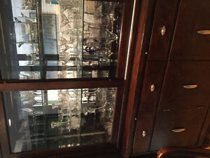 Hutch solid wood with silver accents and glass doors and shelves