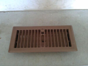 Brown metal floor vent cover heating AC vent cover