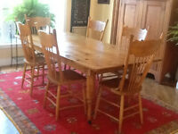 Antique harvest table and 6 press back chairs