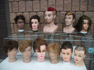 Assorted wigs, mannequin heads with human hair and long necks