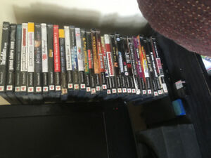 PS2 Slim with 29 games for sale!