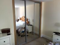 Fitted wardrobe with mirror sliding doors