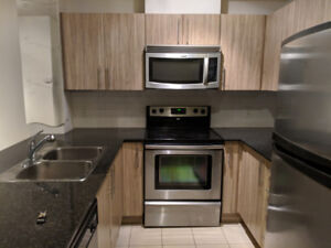 WHIRLPOOL Microwave and FRIGIDAIRE Stove FOR SALE