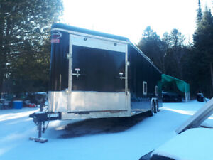 25 x 8.5 Enclosed v-nose trailer with front and rear ramp.