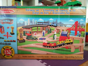 BNIB Melissa & Doug delux wooden train set 132 pieces
