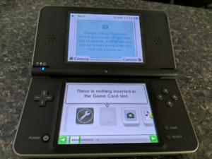 Nintendo DSi xl and two Mario games