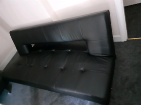 Black faux leather couches. 2 of