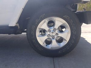 Jeep Wrangler factory tires and rim (excellent condition)