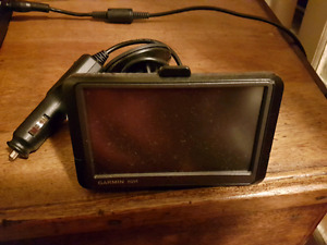 """Garmin nuvi"" GPS. With window suction mount and power supply. W"