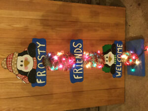 Frosty friends welcome sign