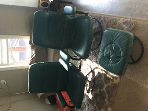Two Green Leather Swivel Reclining Chairs