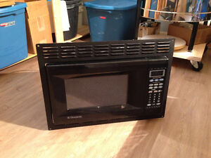 Small Dometic Microwave with black trim kit