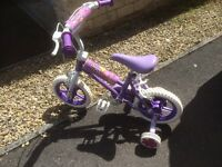 Child's daisy chain girls 12 inch bike for up to 4 Yr old