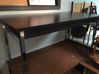 Table with Steel Frame.