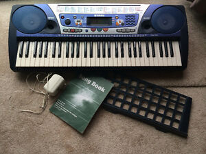 Yamaha PSR262 Portable Keyboard with Stand and Song Book