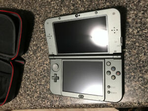 Selling a NINTENDO 3DSxL with c stick with 6 games