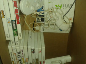 3 Wii controllers c/w 15 games  and 1 Nunchuck