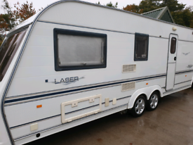 Coachman laser 590/4) twin axle,motor mover,awning, great condition