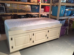 Custom made captains bed with new single matress