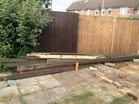 Large pile of decking boards