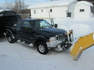 Ford 350 Lariat Diesel 4 x 4 with 9.6  Fisher V Plow