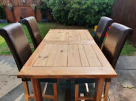 Solid oak dining table with 4x genuine leather chairs