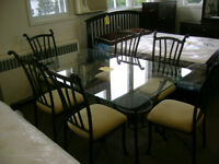 Glass table with 6 chairs. $399.