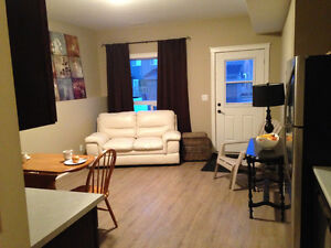 Beautiful bright walk out basement suite in Penhold for rent!