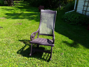 antique rocking chair with caned back