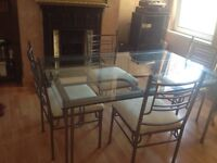 Cast iron dining table and four chairs