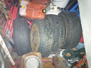 four 15inch studed tires &rims tempra/winter quest