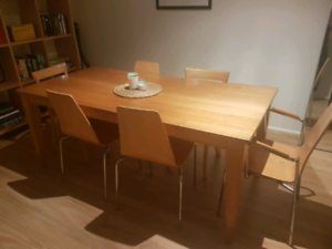 Designer wooden table and six chairs