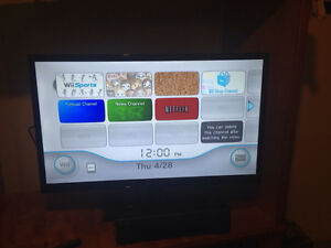 Nintendo Wii with 2 rechargeable remotes