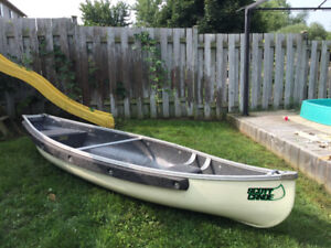11.4 Foot Scott feather canoe with paddles