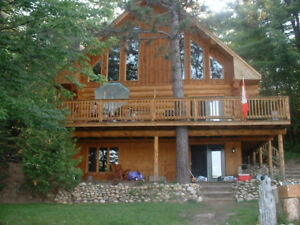 Vacation rental of a lakeside log home 1 hour from Ottawa