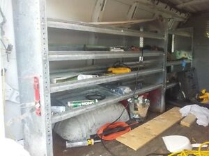 3 storage rack and safety divider to fit a GMC van