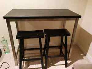 Pub style table with bar stools