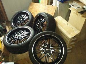 "reduced!! 20"" inch noir rims and 2553520 tires now $1400.00"