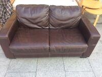 Brown leather 2 seater sofa.