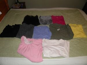 Assortment of maternity clothes.