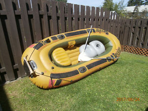 Inflatable 11 foot boat with oars, anchor & other