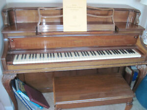 Small piano and bench
