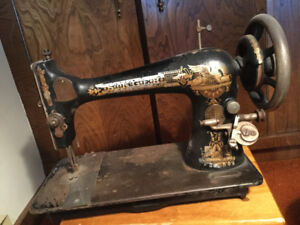 Vintage Singer sewing machine and cover