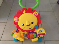 Trotteur lion fisher price en parfaite condition