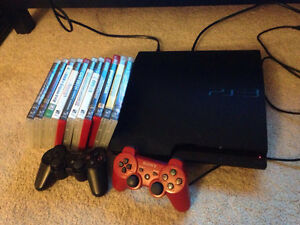 PS3 with 2 controllers, 11 games London Ontario image 1