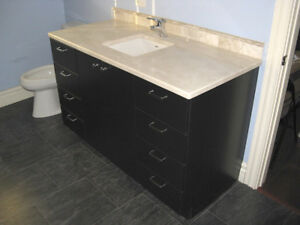 Bathroom cabinets and marble countertops, high quality design.