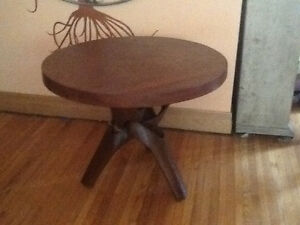 Unique round coffe table with tripod legs , hand carved